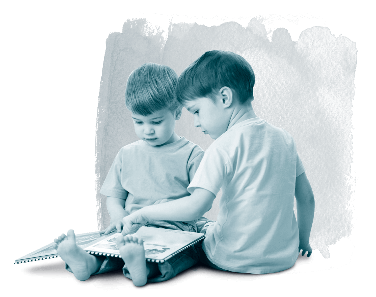 Two boys looking at a book